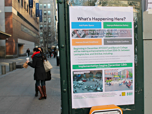 <p>A sign posted on East 25th Street alerts residents and students about the work to convert the block into a public plaza.</p>