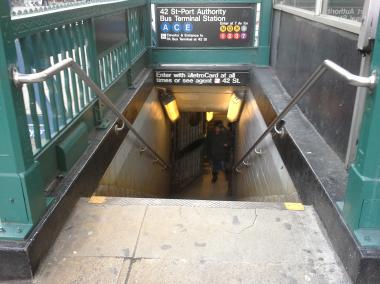 A police officer was injured as he tried to arrest a suspect at the A C E subway station at 42nd Street and Eighth Avenue.