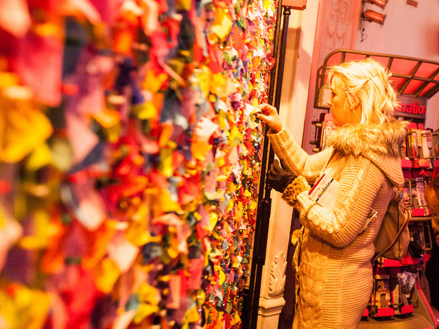 <p>Caoimhe McGiven, 28, from Northern Ireland, pins her confetti wish on the New Year&#39;s Eve Wishing Wall at the Times Square Museum on Dec. 29th, 2012.</p>