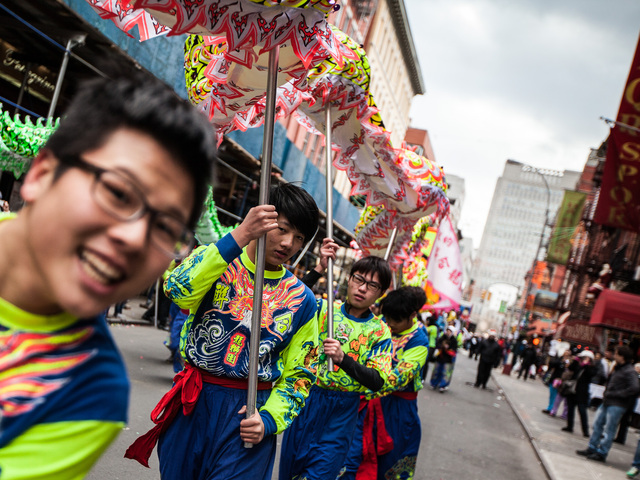 <p>Members of the New York United Lion and Dragon Dance Troupe enjoy the annual East Meets West Parade in Chinatown &amp; Little Italy on Dec. 22nd, 2012.</p>