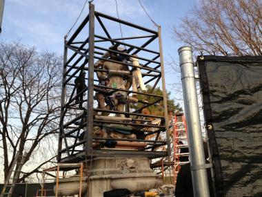 The controversial monument was moved out of Kew Gardens and installed in a Brooklyn cemetery on Monday.