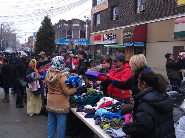 <p>Volunteers lined the streets to give out coats.</p>