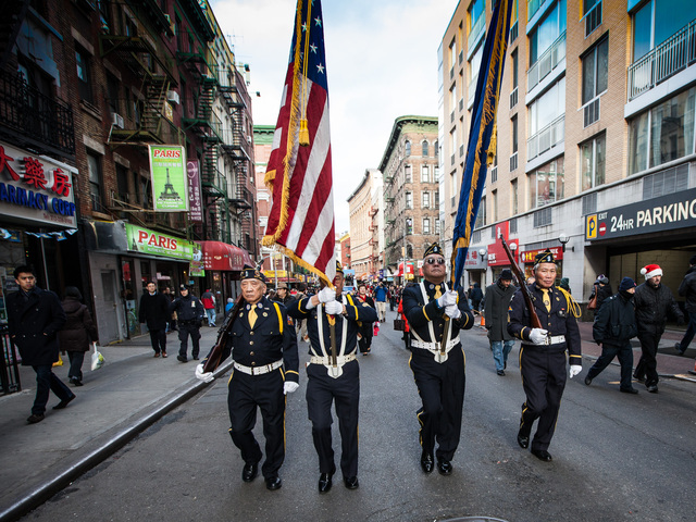 <p>A Color Guard leads of this years East Meets West Parade in Chinatown and Little Italy on Dec. 22nd, 2012.</p>