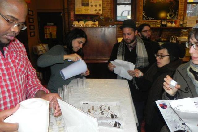 <p>Michelle Cruz, owner of East Harlem Cafe, pours a taste of coquito at the 2011 qualifiers at her eatery.</p>