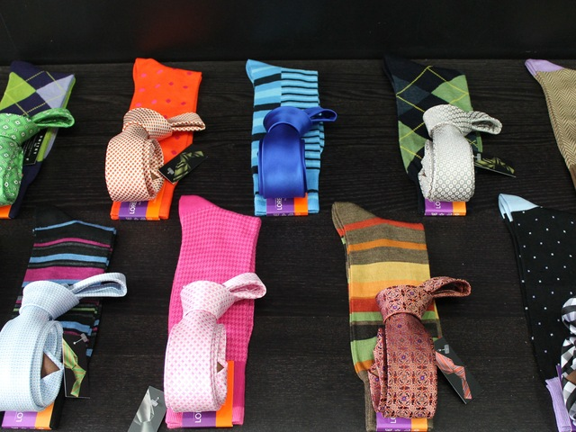 <p>Toscano matches socks with the shop&rsquo;s ties.</p>