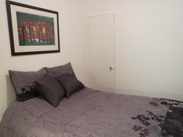 <p>The bedroom of this co-op &mdash; at 531 E. 87th St., 2D &mdash; features a clothes closet as well as a horizontal storage space built into wall, near the ceiling.</p>
