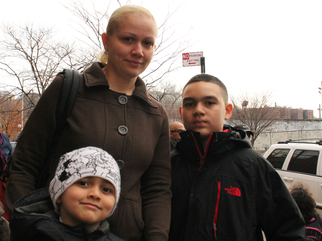 <p>Flavia Guzman and her sons, David (left) and Michael (right), have all attended St. Jude School. &quot;I wanted to bring my kids there becuase I felt comfortable,&quot; Guzman said.</p>