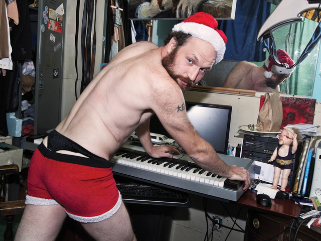<p>Flux Factory artist-in-resident Adrian Owen strips down to his skivvies &ndash; and a Santa hat &ndash; as Mr. December.</p>