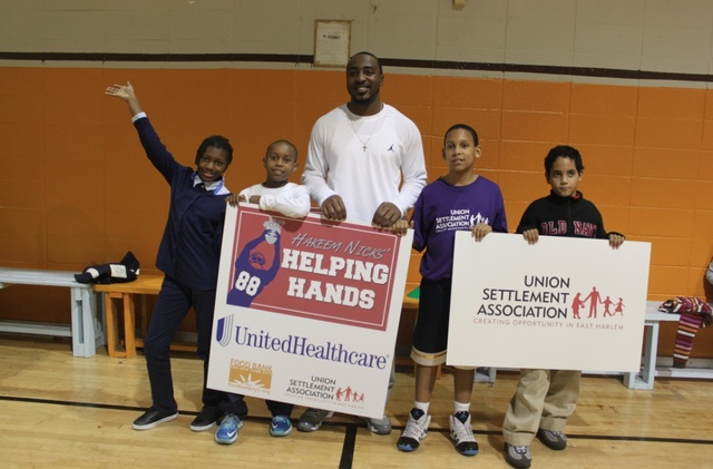 <p>Hakeem Nicks with kids from Union Settlement in East Harlem. The kids will get backpacks filled with healthy food to take home on Fridays.</p>