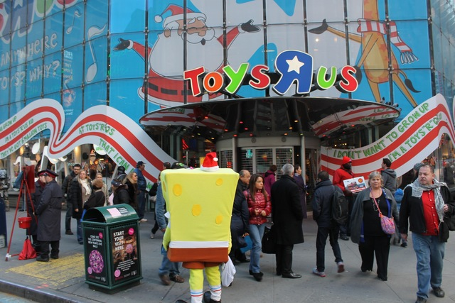 <p>In December, crowds of tourists and shoppers head to Toys R Us in Times Square.&nbsp;</p>