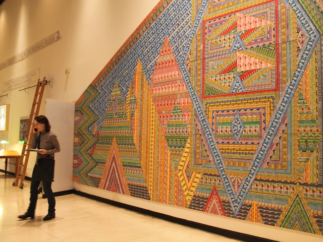 <p>The building&#39;s makeover includes a large mosaic collage along the wall of the lobby made from discarded scratch-off tickets from the art collaboration Ghost of a Dream.</p>