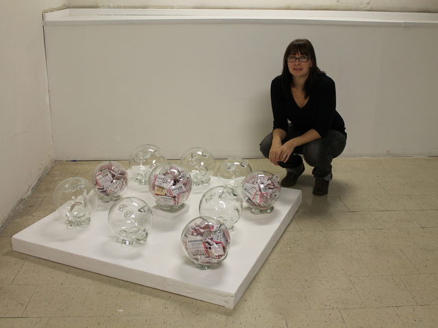 <p>Artist Colleen Ford, 30, filled a series of hand-blown glass piggy banks with her losing lottery tickets.</p>