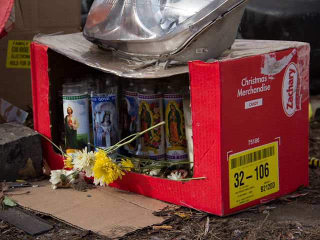 <p>Family and friends set up a memorial for Jose Luis Arlequin, 21, who died after his car struck a light pole on the intersection of Richmond Terrace and Sharpe Avenue, Dec. 31, 2012.</p>