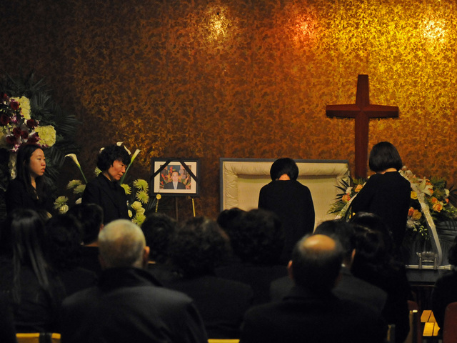 <p>Relatives held a wake for Ki-Suck Han, 58, Dec. 5, 2012, two days after he was pushed in front of a train and killed at a Midtown subway station.</p>