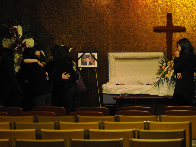 <p>Family members embraced at a Dec. 5, 2012 wake for Ki-Suck Han, 58, who was killed when he was pushed in front of a Q train in Midtown two days earlier.</p>