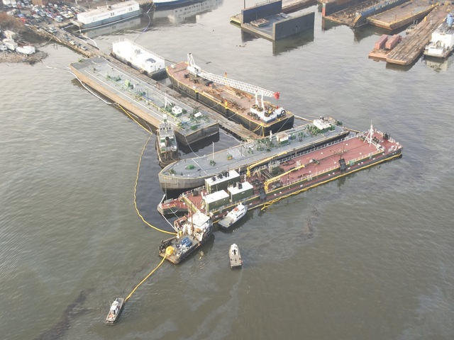 <p>A barge spilt oil into the waters of the Kill Van Kull off of Staten Island on Friday. The Coast Guard said they found 15 oiled birds in the area.</p>