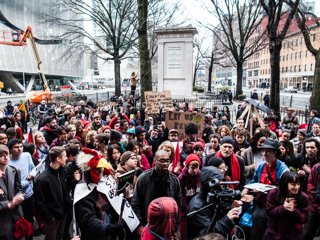 <p>A large crowd gathers outside the Cooper Union School after marching from Washington Square Park on Dec. 8, 2012.</p>