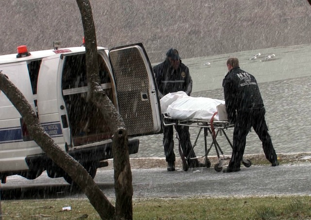 <p>A woman&#39;s body is loaded into a van outside Kissena Lake on Dec. 29, 2012.</p>