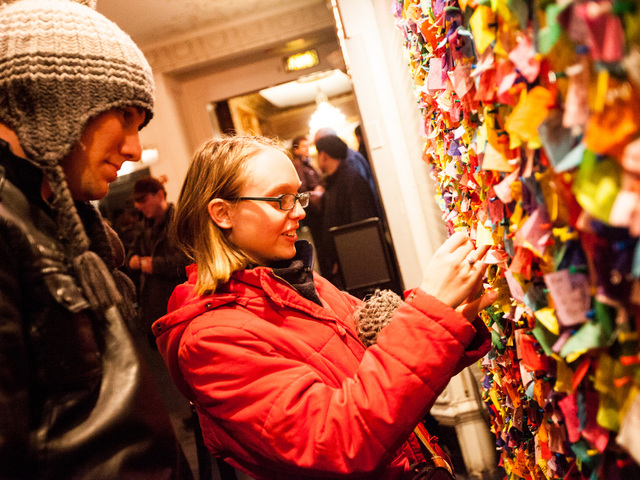 <p>Luke Kingston, 22, from Australia and girlfriend Annie Willat, 21, pin their confetti wishes on the New Year&#39;s Eve Wishing Wall at the Times Square Museum on Dec. 29th, 2012.</p>