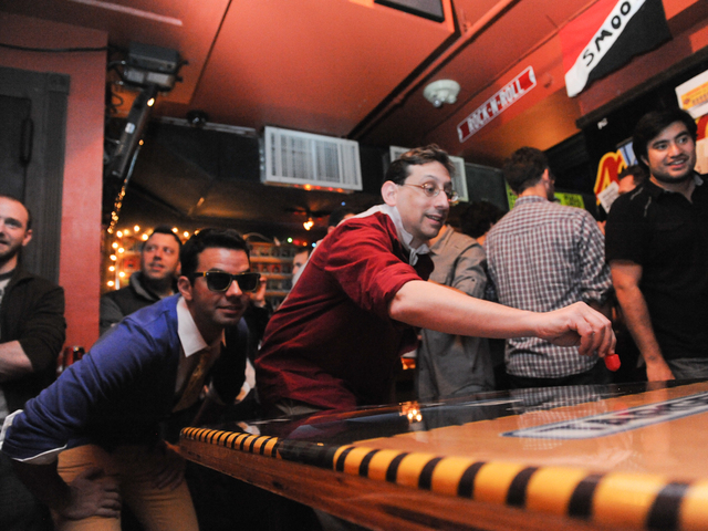 <p>Rob Frank (in sunglasses) and David Goldberg compete against each other at the Major League Dreidel competition at Full Circle Bar in Williamsburg Thursday, Dec. 13, 2012.</p> <p>&nbsp;</p> <p>&nbsp;</p> <p> 	<meta charset=