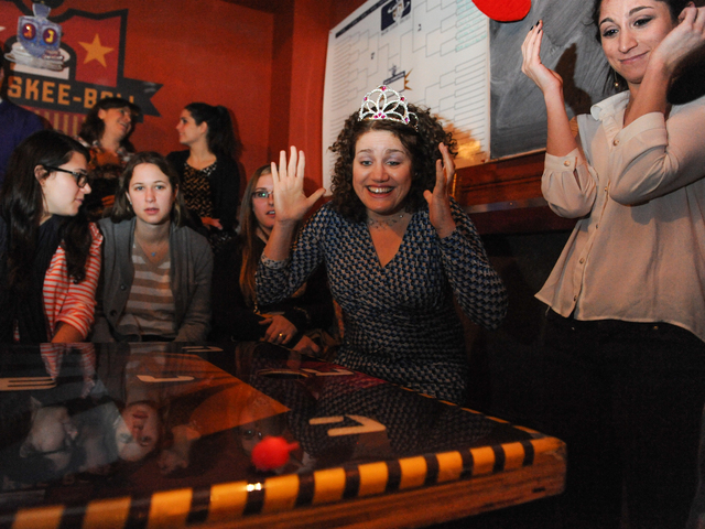 <p>Nora Endlich, in princess crown, reacts to her opponent&#39;s dreidel move at the competition.</p>