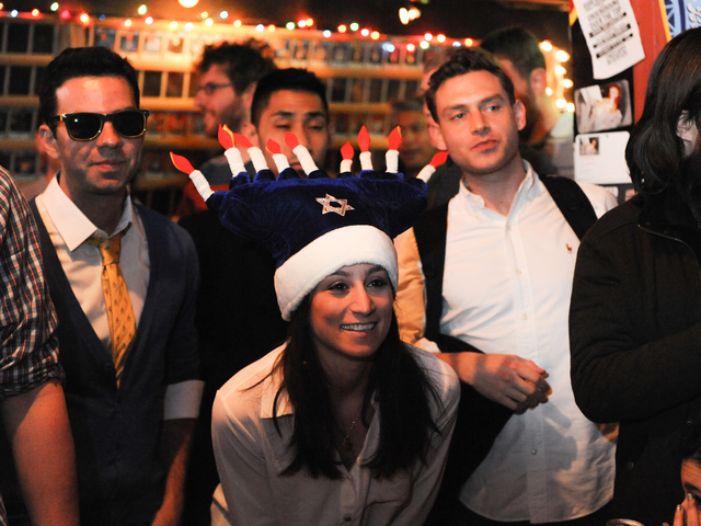 <p>Rachel Koch wears a festive Hanukkah hat to the dreidel competition.</p>