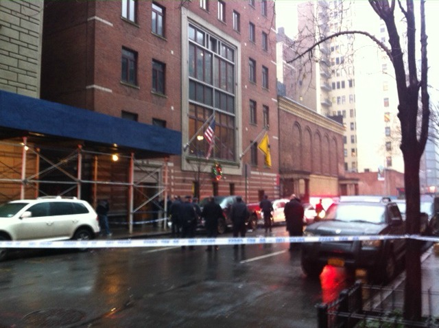 <p>Police tape blocked off West 58th Street where a man was shot in the head Dec. 10, 2012.</p>