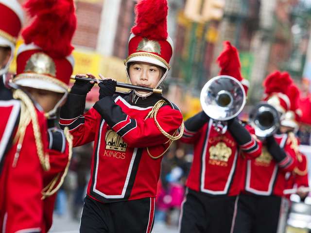 <p>The Crimson Kings marching band plays at the East Meets West Parade in Chinatown &amp; Little Italy on Dec. 22nd, 2012.</p>