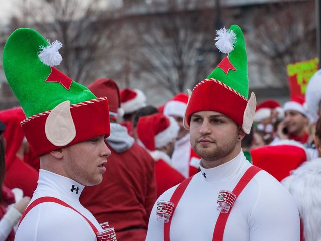 <p>Two men dressed as elves during SantaCon 2012.</p>