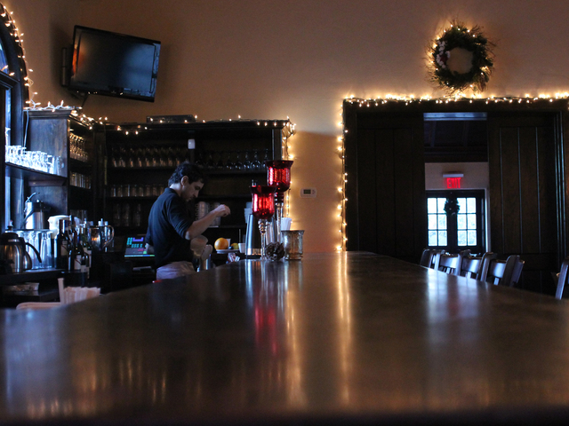 <p>A bartender serves up a hot chocolate at New Leaf restaurant.</p>