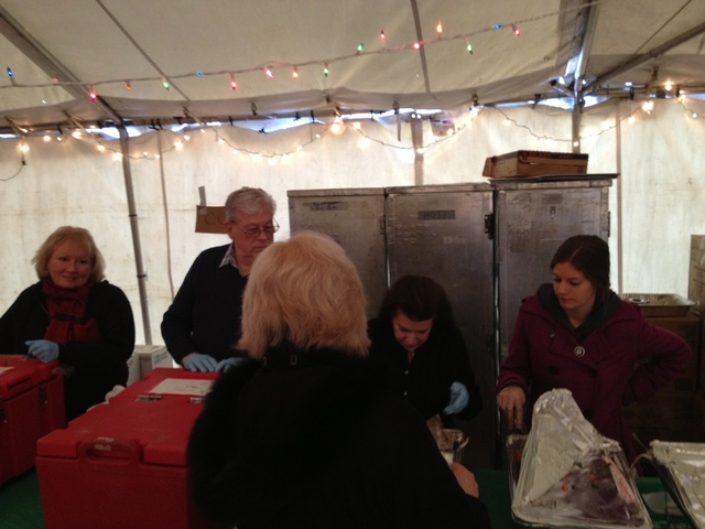 <p>Richard Blanck, second from left, his wife, Pat, second from right, and Red Cross worker Carolyn Ross, far right, served food at a Red Cross warming center in Belle Harbor Dec. 25, 2012.</p>