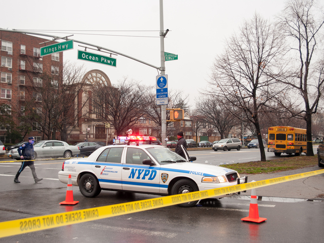 <p>A police cruiser at Kings Highway and Ocean Parkway, where a pedestrian was struck by a school bus on Tuesday December 18th, 2012.</p>