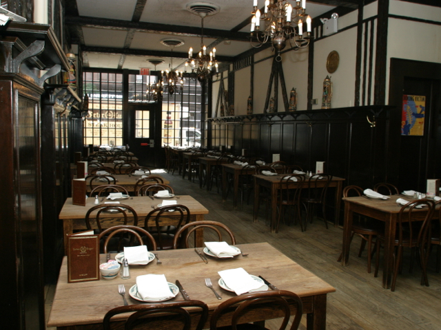 <p>The dining room at Peter Luger in Brooklyn.</p>