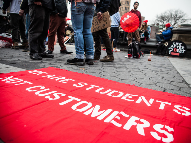 <p>A protest sign states, &quot;We are students, not customers,&quot; in Washington Square Park during the Cooper Union student rally on Dec. 8, 2012.</p>