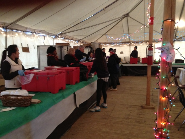 <p>A Red Cross tent offered hot meals in Belle Harbor Dec. 25, 2012.</p>