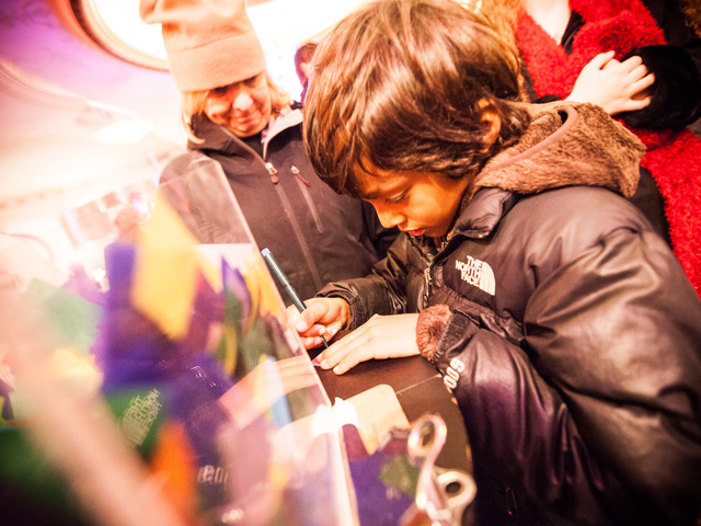 <p>Ryan Stokes, 6, from Charlotte, North Carolina, writes his New Year&#39;s wish on a piece of confetti at the Times Square Museum on Dec. 29th, 2012.</p>