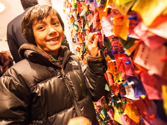 <p>Ryan Stokes, 6, from Charlotte, North Carolina, pins his confetti wish on the New Year&#39;s Eve Wishing Wall at the Times Square Museum on Dec. 29th, 2012.</p>