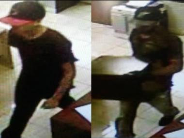 Police are looking for two men accused of stealing a safe from an Astoria building Sept. 16, 2012.