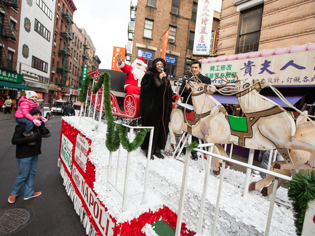 <p>Santa Claus waves to crowds alongside singers Cheryl Warfield and John Carelli at the annual East Meets West Parade in Chinatown &amp; Little Italy on Dec. 22nd, 2012.</p>