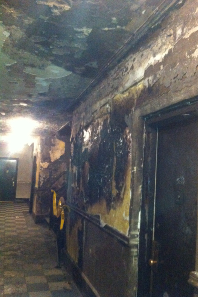<p>The building&#39;s second-floor hallway after the fire.</p>