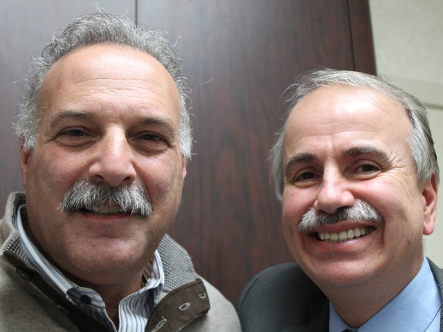 <p>Astoria business owners Paul Halvatzis (right) and Gary Bonelli (left) have offered to shave their mustaches to raise money for a local autism services organization.</p>