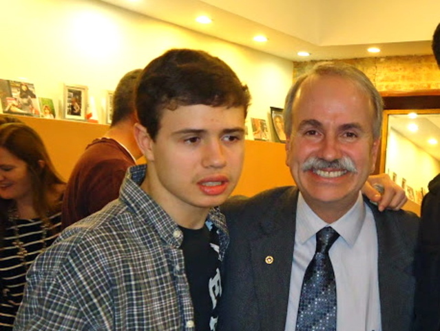 <p>Paul Halvatzis with his son, Paulie Halvatzis, at their fundraiser party last year.</p>