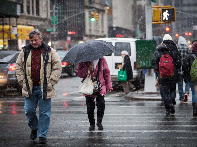 <p>Snow pelted pedestrians walking through Chinatown Wednesday afternoon, Dec. 26, 2012.</p>