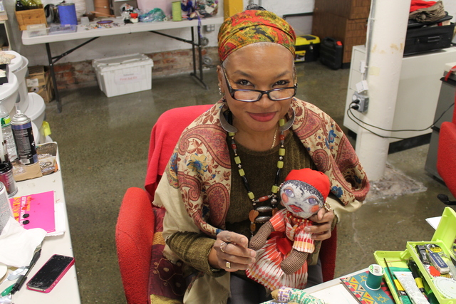 <p>Artists Donna Brew with one of her creations at SoHarlem</p>