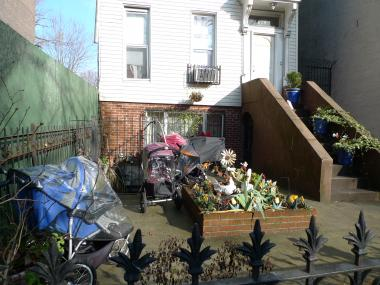 Strollers in front of a Seventh Street house where a thief stole $700 in valuables from an unattended stroller on Dec. 13, according to police.