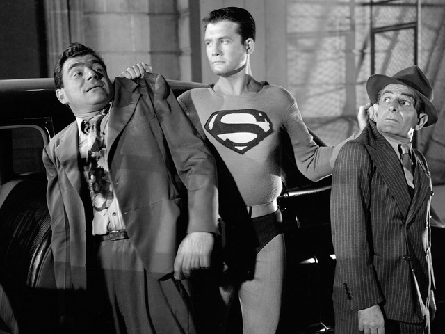 <p>Superman, played by George Reeves, nabs two crooks in the 1950s TV series &quot;Adventures of Superman.&quot;</p>