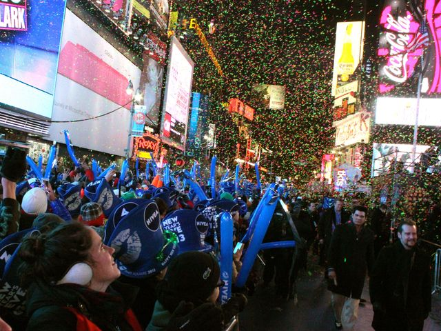 <p>Confetti is released over Times Square revelers as midnight draws near.</p>