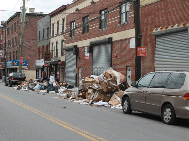 <p>A man walks past a pile of trash on Van Brunt Street in Red Hook Friday afternoon, Dec. 21, 2012. The trash heap has been growing for weeks following Hurricane Sandy.</p>