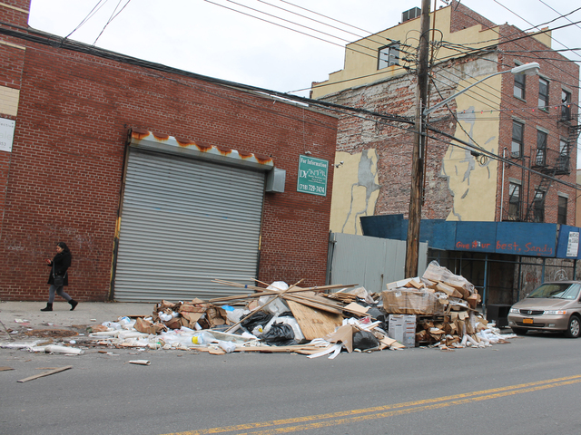 <p>A woman walks past a pile of trash on Van Brunt Street in Red Hook Friday afternoon, Dec. 21, 2012. The trash heap has been growing for weeks following Hurricane Sandy.</p>