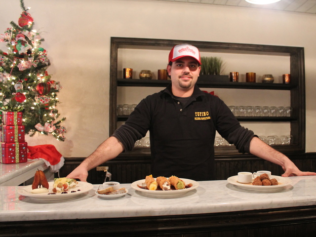 <p>Pastry chef Savvas Ioannou shows off his desserts at Tufino Pizzeria Napoletana, which opened at 36-08 Ditmars Blvd. on Tuesday, Dec. 18, 2012.</p>